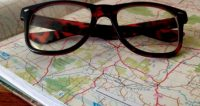 glasses on map