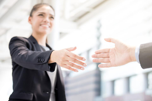 woman shaking hands